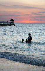 Runaway Bay, Jamaica (Wandering Sole Images) Tags: ocean sunset beach swimming children sand waves shoreline mother jamaica caribbean seashore runawaybay