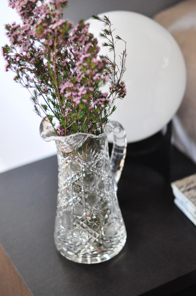 purple flowers in vintage crystal pitcher