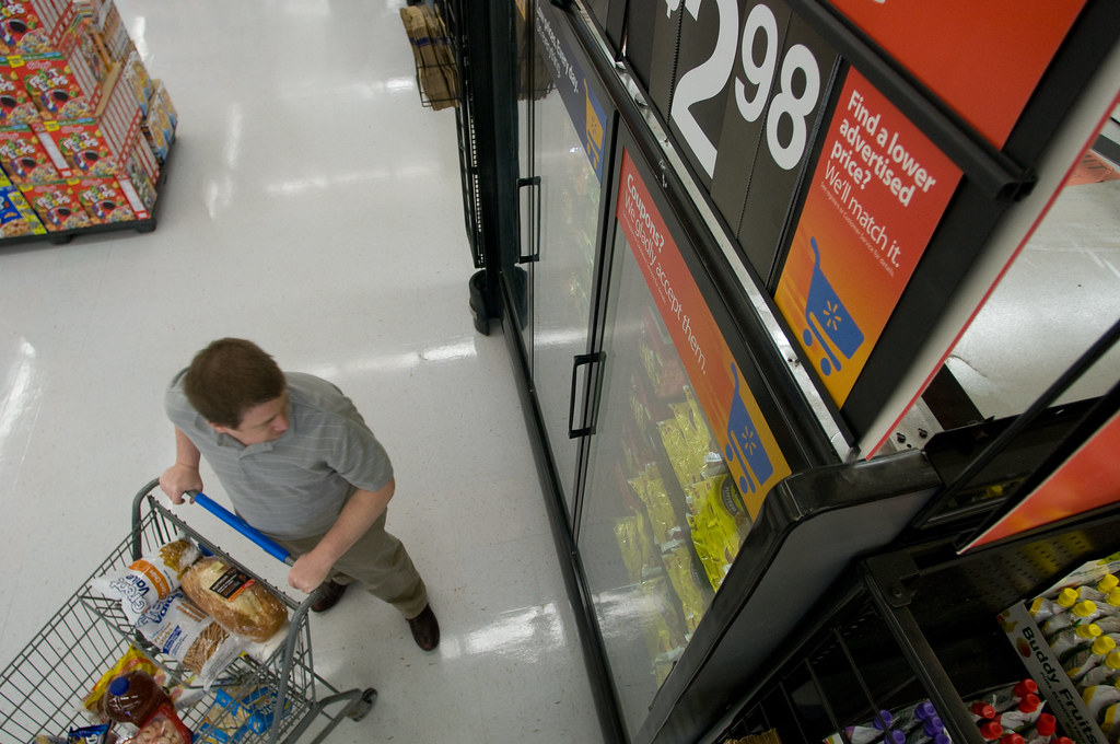 Walmart Shopper Selects Frozen Food Items from the New Display Case
