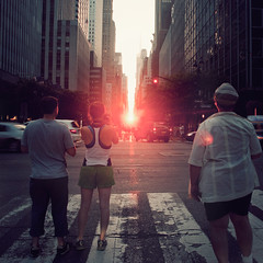 the light. (Vitaliy P.) Tags: street new york city nyc light sunset red people orange sun square nikon path manhattan candid east midtown explore crop gothamist crosswalk setting 2010 manhattanhenge explored d80 18135mm vitaliyp