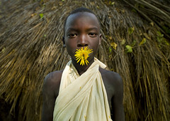 Surma boy with flower - Omo valley Ethiopia (Eric Lafforgue) Tags: africa flowers boy people colour childhood gabi horizontal youth fleurs outside outdoors person kid child decorative decoration jeunesse ornament innocence omovalley shawl ethiopia tribe enfant surma naivete personne humanbeing contemplation adornment afrique ornement tribu dehors omo eastafrica garcon suri enfance 901 abyssinia ethiopie exterieur lookingatcamera traditionalclothes waistup abyssinie vueexterieure coloredpicture photocouleur decoratif afriquedelest surmatribe alataille etrehumain habittraditionnel suripeople valleedelomo peuplenomade regardantlobjectif turgit peoplesoftheomovalley surmapeople peuplesdelavalleedelomo villageofturgit villagedeturgit tribudessuri suritribe tribudessurma peuplesuri peuplesurma colouredpicture cadragealataille