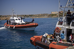 Fleeing Libya by Sea (UNHCR) Tags: sea italy coastguard boats island europe tunisia help aid conflict arrival shelter libya protection assistance unhcr westerneurope mediterraneansea vessels southerneurope boatpeople migrants rescueatsea unrefugeeagency mixedmigration