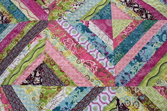 quilted in line (Midwest Family Life) Tags: colors toddler paradise quilt bright paperpiecing stringquilt patriciabravo patbravo straightlinequilted