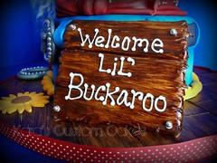 Lil' Buckaroo Baby Shower Cake (Kara's Custom Cakes) Tags: wood sign belt rope sunflowers horseshoe bluejeans bandana paisley cowboyhat woodgrain babyblanket sleepingbaby beltbuckle lasso cowboycake babyshowercake westerncake fondantbaby lilbuckaroocake littlebuckaroocake lilbuckaroobabyshower cowboybabyshowercake fondantcowboy