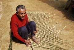 Man making mat (Noel Molony) Tags: family children rice health stories waterpumps healthcentre monvillage concernstaff educationonhealth hamkongvillage haumeuangdistrict pakhataivillage pasortvillage salongvillage salorvillage samhouay sopkhamvillage tarkaivillage thathvillage