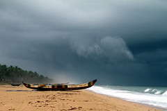 The sky is never blind (Délirante bestiole [la poésie des goupils]) Tags: africa blue sky storm boat seaside day village benin pirogue afrique ouidah bénin touraroundtheworld eos5markii