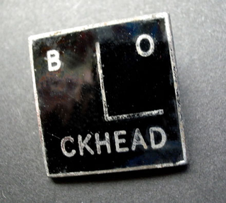 Barney Bubbles' Blockhead logo - enamel badge 1978.