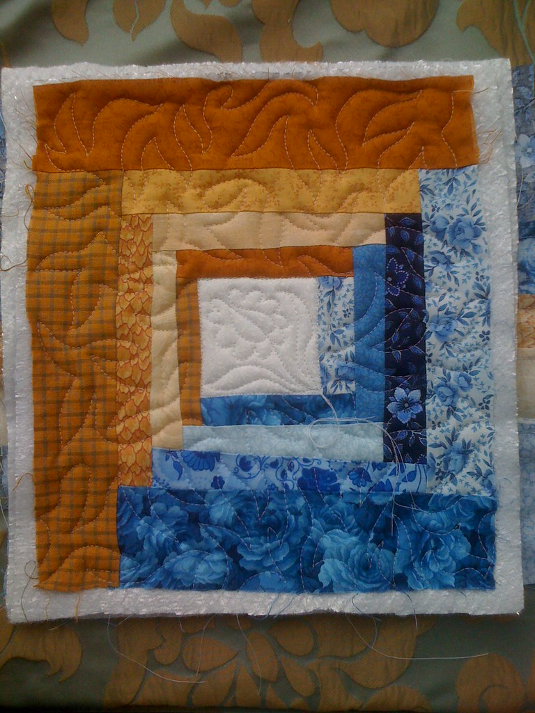 Quilting Practice on a Wonky Log Cabin potholder