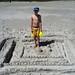 Building a sandcastle on the beach