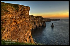 Scenic Irish Sunset Nature Landscape Rural Countryside Photography. The Cliffs of Moher Mohair Seascape, County Clare, Ireland Irlanda. (upthebanner) Tags: active adventure atlantic beach big blue burren clear cliff cloud coast coastline cool doolin dusk epic extreme famous green hdr high highest huge ireland irish landscape moher nature ocean outdoor panorama panoramic place power recreation rock rocky scene scenery scenic sea sight sky sunset travel view water wave weather west nikon noel moore irlanda european world surfing waves upthebanner clare county business trip sailing vacation tourism family attraction liscannor cruise boat night