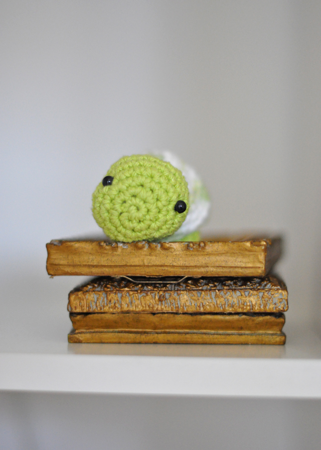 crocheted turtle on mini gold mirrors