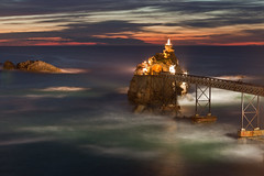 Rocher de la Vierge (Virgin's Rock) (seryani) Tags: ocean longexposure light sunset sea france reflection sol beach canon reflections atardecer evening mar twilight europa europe dusk playa reflejo bluehour francia plage canonef2470mmf28lusm 2470l biarritz anochecer aquitaine 2470 rocherdelavierge virgendelaroca canoneos5dmarkii 5dmarkii virginsrock