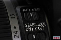 Image stabilisation objectif photo bouton