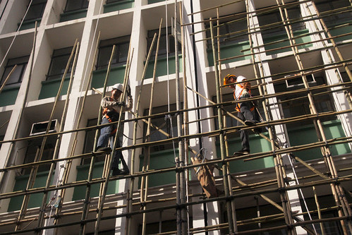 Workmen erect bamboo scaffolding in Hong Kong