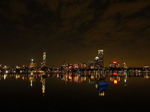 Boston at night with sailboat
