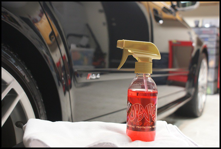 Dodo Juice Red Mist Tropical ready to be applied to a clean metallic black Audi RS4