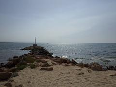 Liopetri Fishing Harbour (Michael Blacktom) Tags: ocean morning blue light sea sky sun beach water sunrise boat fishing rocks harbour cyprus greece napa signal beacon fishingharbour aiya harbourlight aiyanapa liopetri