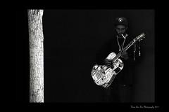 Pasadena Street Photography - The Guitarist (Hsin Tai Liu) Tags: california street old portrait musician white black tree canon photography eos town liu flickr guitar cigarette tai mm 135 pasadena 18 hsin guitarist stumbleupon 50d tumblr