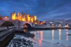 Conwy Castle (Meleah Reardon) Tags: uk blue people castle tourism wales landscape lights 1 long exposure flood no united kingdom medieval edward hour majestic conwy