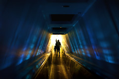 Exit into the Next Millennium (Joseph Vernuccio) Tags: silhouette holdinghands wdw waltdisneyworld magickingdom spacemountain waltdisney tommorwland nikond700 nikon50mmf14g
