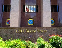 1201 Brazos Street, Austin, Texas (Texas State Library and Archives Commission) Tags: trees light shadow sky sunlight reflection building tree green lines architecture clouds austin reflections mexico daylight cloudy flag columns entrance americanflag bluesky streetscene scene pole shade dome granite seals greenery pavilion column tall shrub gilded address starsandstripes pavillion redwhiteblue usflag portico texascapitol windowreflection texasstatecapitol lonestarstate redgranite texascapital stategovernment texashistory kingdomofspain kingdomoffrance lorenzodezavalastatearchivesandlibrarybuilding texasstatelibraryandarchivescommission