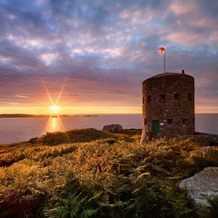 Loophole Tower, L'Ancresse (PhotoToasty) Tags: sunset tower sunstar lancresse loophole subtlehdr
