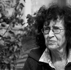 An introduction to wrinkles (Neil. Moralee) Tags: woman lady mature old wrinkle face close portrait hair glasses poeple outdoor candid black white bw monochrome mono blackandwhite free pursed lips stern frown anger anoyed niel moralee nikon d7100 18300mm uk