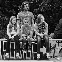 One is not interested... (Akbar Simonse) Tags: dscn4129 denhaag thehague agga haag sgravenhage lahaye peope man kids children candid streetphotography straatfotografie zwartwit bw blancoynegro bn monochrome vierkant square akbarsimonse girls