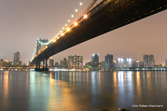 Manhattan Bridge (Rafakoy) Tags: city nyc longexposure bridge light urban ny newyork color water colors fog skyline architecture brooklyn night river lights nikon cityscape manhattan perspective dumbo manhattanbridge eastriver d800