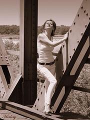 Ilona (Harlory) Tags: bridge portrait bw woman sun girl beautiful model nikon railway romania coolpix p100 slatina