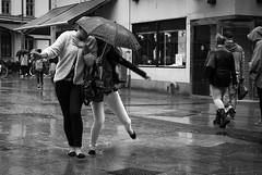 Rain dance (Olderhvit) Tags: street girls blackandwhite rain umbrella göteborg lumix rainyday gothenburg streetphotography panasonic streetphoto petri regn goteborg paraply gatufoto gatufotografi framingthestreet olderhvit dmcgx1 p111079
