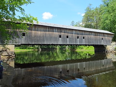 Hemlock Covered Bridge (RonG58) Tags: pictures new trip travel bridge light sky usa color water clouds river landscape geotagged photography us photo spring day image photos live maine picture bluesky images photograph coveredbridge digitalcamera exploration mizu photooftheday picoftheday leau sacoriver fryeburg fugifilm elagua daswasser hemlockcoveredbridge dailynaturetnc12 rong58 finepixhs50exr
