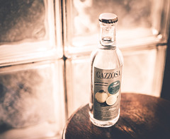 [ r i c o r d i ] (chleggiero) Tags: bottle glass orange light drink indoor shadows 35mm film taking