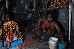 Thousand reasons for a smile (Rajib Singha) Tags: travel street indoor art artist idol flash offcamera interestingness flickriver nikond200 mfnikkor20mmf35aislens kumartuli kolkata westbengal india