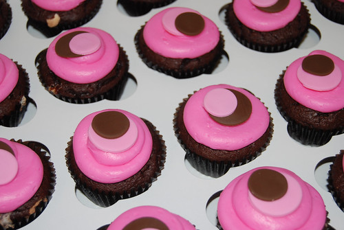 pink and brown sassy circle cucpakes for monkey baby shower cupcake tower