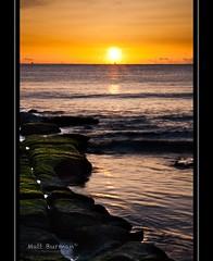 TO THE END OF THE WORLD (matt burman) Tags: ocean sea sun lighthouse colour water night sunrise timelapse rocks waves ship nighttime algae soldiersbeach