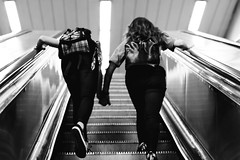 Budapest subway n. 2 (helix.pomatia) Tags: bw blackandwhite blackwhite black whiteblack white bianconero biancoenero monochromatic monochrome monocromo contrast contrasts light lights run running friend friends friendship girl girls nikon digital 50mm metro subway budapest budapest2016 buda