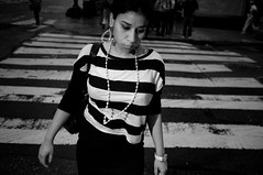 The White Stripes (syphlix) Tags: street nyc bw newyork lines necklace fuji sad geometry manhattan candid stripes midtown handheld pearl crosswalk nocrop whitestripes tt5 tt1 x100 offcameraflash pocketwizard pearlearrings strobist nikonsb28