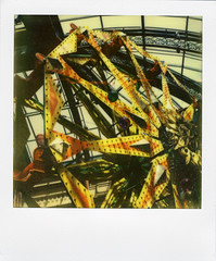 Bellagio's Ferris Wheel (Nick Leonard) Tags: city vegas flowers orange film yellow analog balloons polaroid sx70 hotel colorful lasvegas nevada nick decoration conservatory casino ferriswheel bellagio flowergarden polaroidsx70 instantfilm epson4490 firstflush colorshade nickleonard polaroidsx70model2 theimpossibleproject summer2011 px680 px680ff summer2011theme