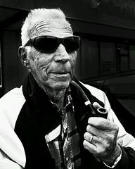 Piper #1 (Photo Captured) Tags: portrait blackandwhite bw senior pipe smoking nostalgic oldtimer streetphoto seniorcitizen pipesmoker flickrandroidapp:filter=none