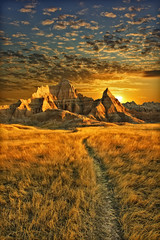 badlands sunrise - badlands national park, south dakota (Dan Anderson (dead camera, RIP)) Tags: camping vacation sky usa mountain grass yellow clouds southdakota blackhills america sunrise landscape gold dawn golden nationalpark amazing hiking path bad scenic trail sd springbreak stunning badlands prairie lands plains breathtaking walldrug goldrush badlandsnationalpark sioux trailhead greatplains