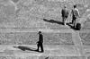 incroci e distacchi (Maieutica) Tags: sun man milan men lines walking shadows stones walk milano ombre uomo pietre sole uomini palazzoreale linee camminare