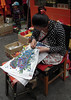 A girl sewing embroidery (Quynh-Loan) Tags: embroidery sewing tibet tibetangirl