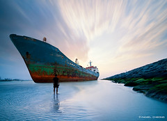 Lady Rana (DanielKHC) Tags: abandoned beach composite lady clouds digital boat nikon rust rocks long exposure dubai ship uae manipulation wreck rana dri hdr blending d300 danielcheong danielkhc tokina1116mm