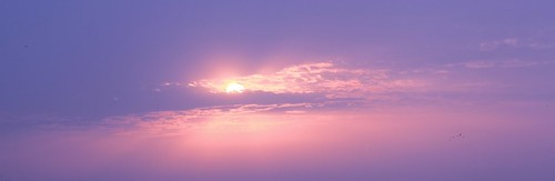 Sun behind the sky