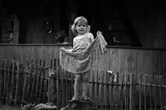 with style (gagilas) Tags: wood woman house girl smile fence happy child dress longhair posing ne explore woodenfence countryhouse guste lookingstraight villagecatwalk taip ne4 ne2 bythefence ne3 gimbogala taip2 taip5 taip7 taip10 taip3 taip4 taip6 taip8 taip9 fotofiltroauksas