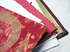 gold and red, mixed papers