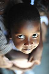 Hope (Rory.Cunningham) Tags: boy love smile haiti eyes nikon hug child availablelight 50mm14 christian cheeks need april mission hold 2011 hatian d700 dufailly