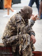 Man resting (ZUCCONY) Tags: barcelona man rags smoking newport marlboro performer ramblas 2010 riches pedrozucco httpswwwfacebookcombobbyzuccophotography