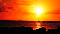 Fire in the sky (Thielzy) Tags: ocean sunset sun water silhouette